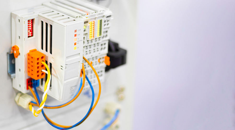 Close-up of Electric cabinet with a fieldbus module for smart home or industrial automation.